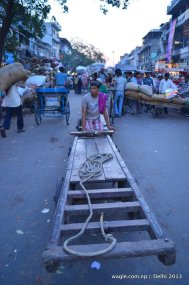 Rickshaw puller waiting for a load