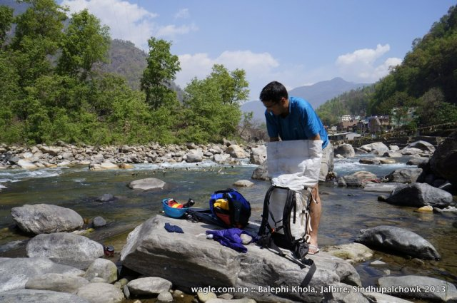 At the Balephi river, still full of confident, I unpacked the raft, inflated it and started paddling. Peter went ahead. I quickly followed only to hit a rock in the first rapid that was within 30 meters from our starting point.