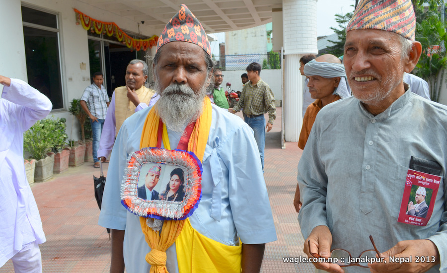 """King"" and ""Queen"" in their hearts. The man on the left, resident of Dhanusha district of which Janakpur is headquarter, camped at the hotel for two days to get a glimpse of the ex-king. Yesterday he wore daura suruwal."