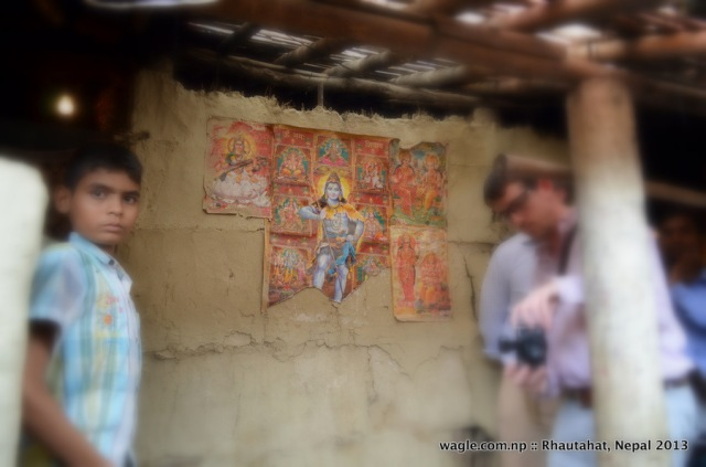 Religious posters pasted on the wall of a house owned by a Dalit in Pipariya Dostiya village of Rhautahat district.