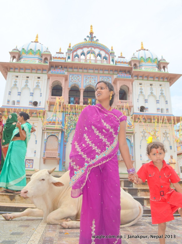 A woman waited for her family members as she held her child in Janaki temple complex in Janakpurdham.