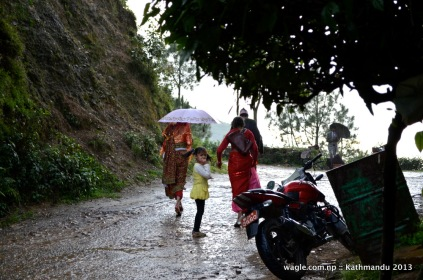 a bride walks in the rain..to her new home beneath the hill