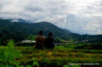 our camera spotted a couple busy observing villages from a hilltop