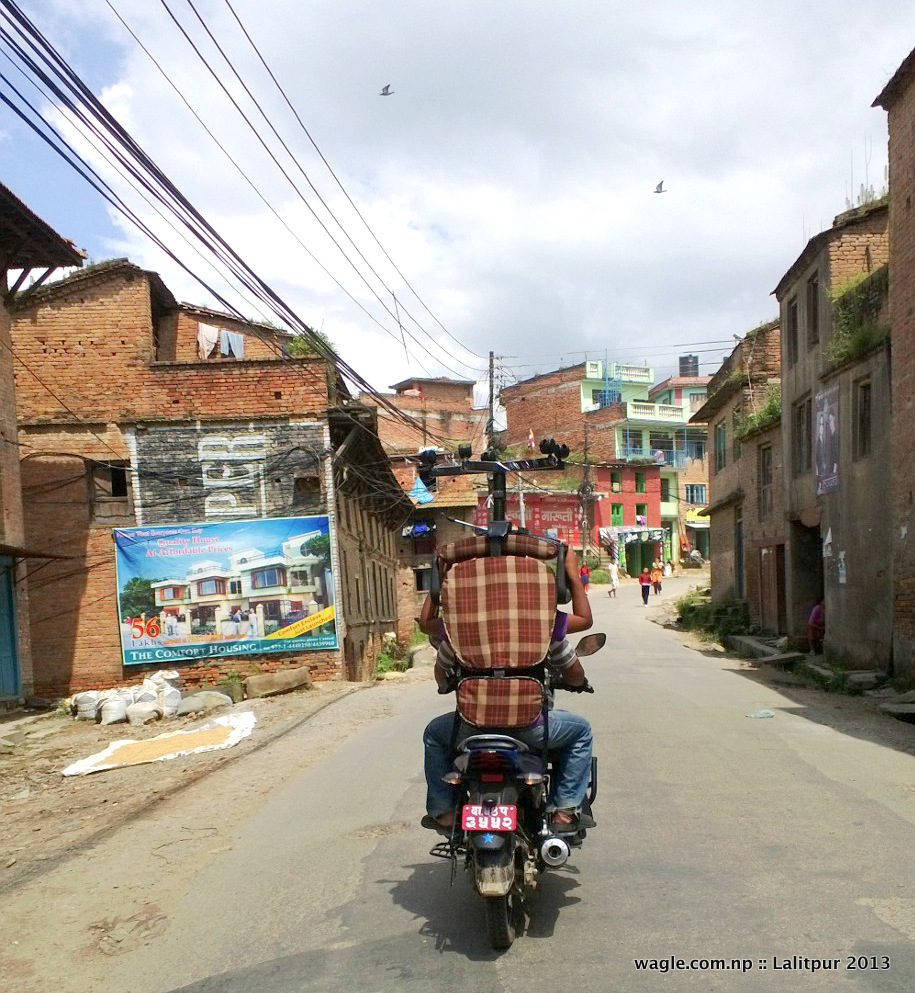 two people on a bike and a chair over their head