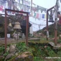 Phulchowki- bells, prayer flags and trishuls