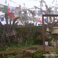 Phulchowki- bells, prayer flags and trishuls