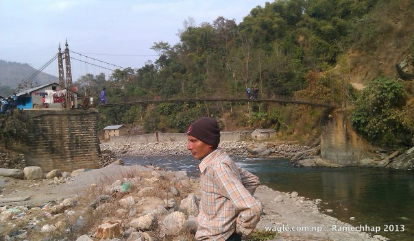 Likhu Khola. Ramechhap district on this side of the river, Okhaldhunga district on that side of the river.