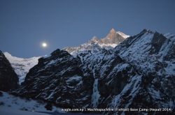 Rays of sunlight hit the western rocky face of Mt Machhapuchhre (Fishtail) as the moon rose from the east. As seen from MBC.