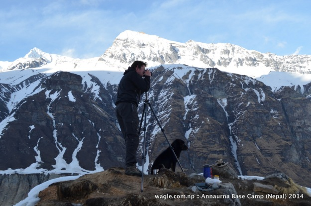 A dog accompanied a photographer at the Annapurna Base Camp viewpoint