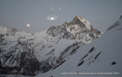 A light bulb, middle, got reflected on the window pane of a hotel in Annapurna Base Camp that offered a view of the moon rise and Mt Machhapuchhre