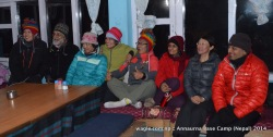 Chinese and Indian tourists posed for a group photo inside the dining hall of a lodge at the Annapurna Base Camp