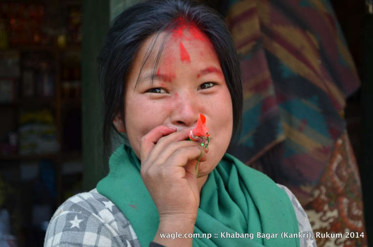 A girl tried to blow up a balloon in Khabang Bagar, Rukum where we stayed overnight before heading to Thabang, Rolpa.