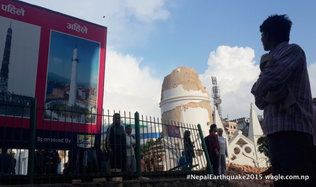 Dharahara destryed. The hoarding board shows the images of Dharahara- before the great earthquake of 1930 (then) and after it was rebuilt (now). This photo, taken a day after the #NepalEarthquake, depicts the ruins of the famed tower.