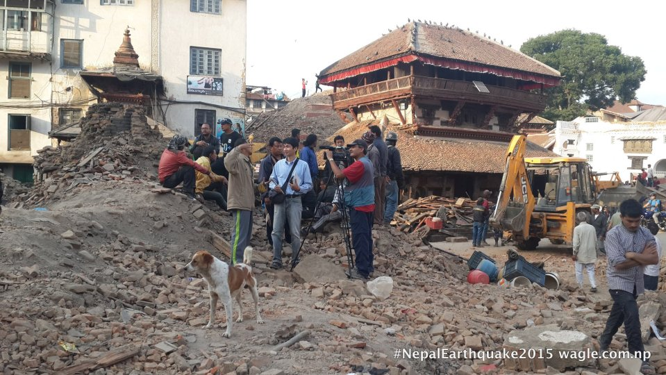 A day after the #NepalEarthquake, I saw a dog and a crew of Japan's NHK TV at the site where the Kastamandap temple stood once.
