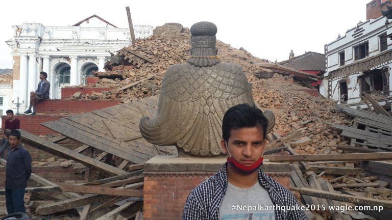Statue of Garuda, in praying mode, stood still at the entrance of completely demolished Trailokya Mohan Temple.