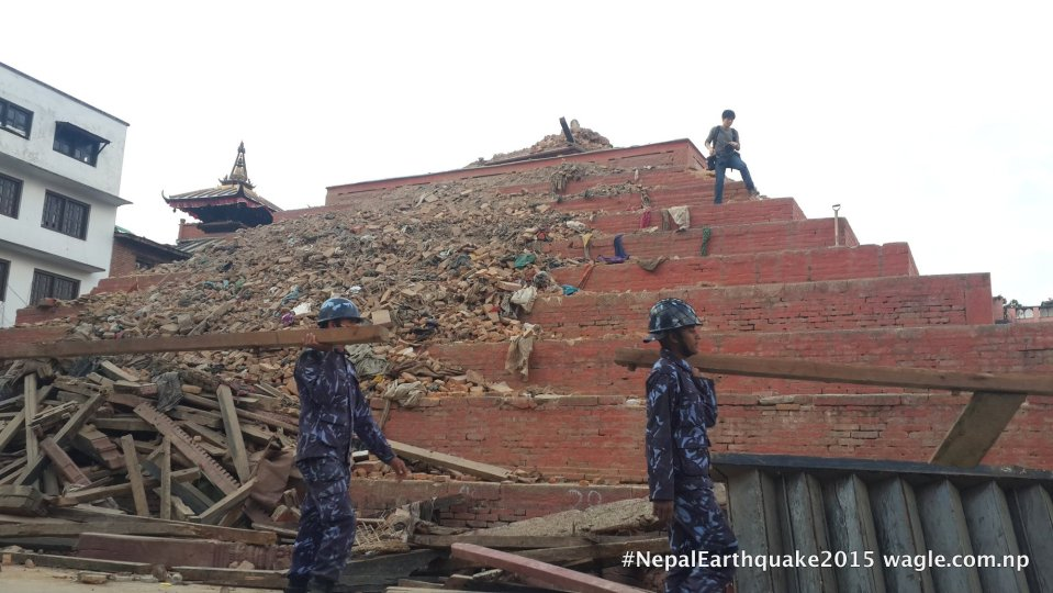 A day after the #NepalEarthquake, policemen were clearing the rubble and retrieving invaluable woodcarvings from the fallen Maju Deval Temple in Kathmandu Darbar Square.