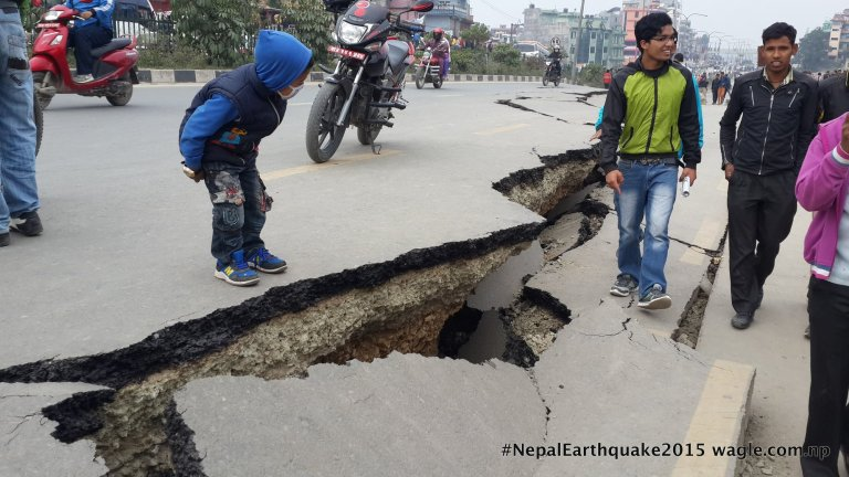 Severe cracks on Kaushaltar-Lokanthali section of the Japanese-built highway. The quake not only inflicted damage on the sturdy road but sunk the residential area the size of about 10-15 football fields by about 1.5 feet. A few concrete houses in the area have suffered serious damage.