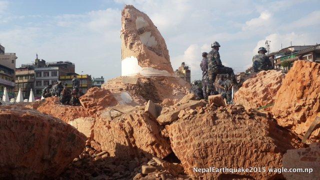 Policemen guard the ruins of the fallen Dharahara