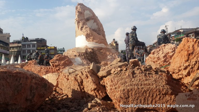 Policemen guard the ruins of the fallen Dharahara