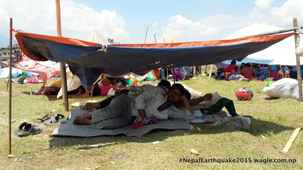 Men from the plains who came to Kathmandu to work. Now, they're  now under a tent like everyone else.
