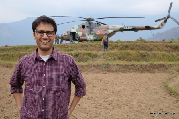 A Nepal Army MI17 parked on a corn field.