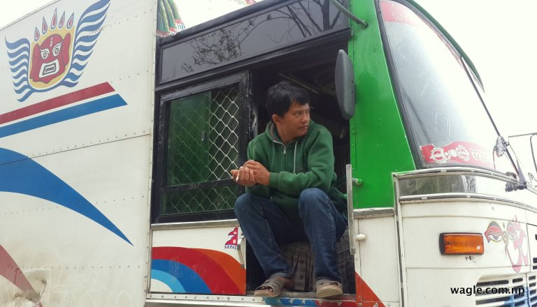 A truck driver waiting for the green light.