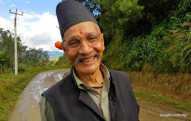 Surya Bahadur Gopali on his way back home in the Gahate neighbourhood of Bajrabarahi valley after making a leisurely trip to the bazaar.